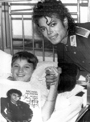 Mike visiting Ryan in the hospital