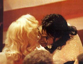 Mike and Madonna sharing a secret at some awards ceremony